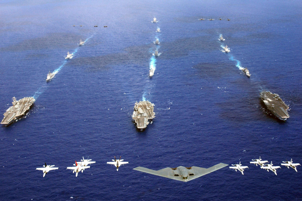 A B-2 Spirit and 16 other aircraft from the Air Force, Navy and Marine Corps fly over the USS Kitty Hawk, USS Ronald Reagan and USS Abraham Lincoln carrier strike groups in the western Pacific Ocean on Sunday, June 18, to kick off Exercise Valiant Shield 2006. (U.S. Navy photo/Chief Photographer's Mate Todd P. Cichonowicz)